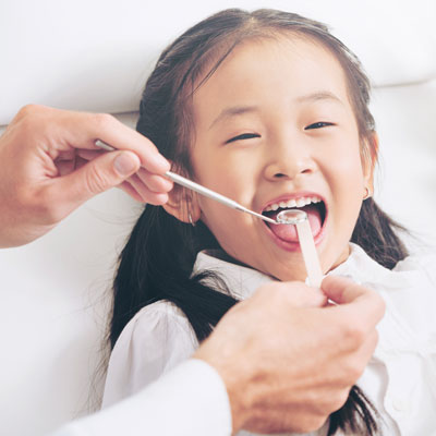 Young girl getting dental exam