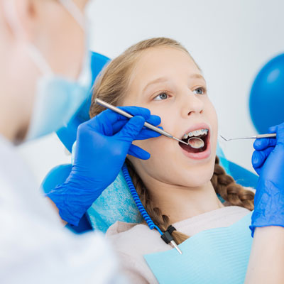girl in a dentist office with braces
