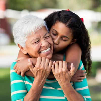 Young girl hugging grandmother