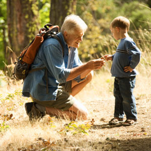 Grandfather and grandson hiking