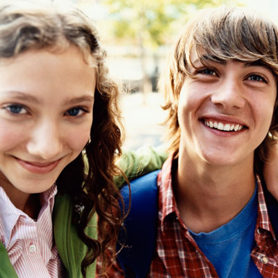 smiling teens boy and girl