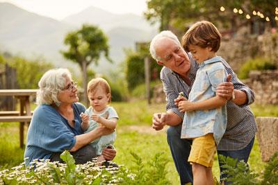 Grandparents gardening with grandchildren