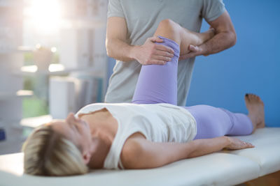 Woman exercising knee