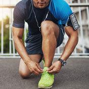 Man lacing up running shoes