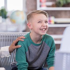 Boy sitting in chair