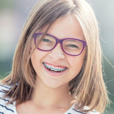 Girl with glasses and braces