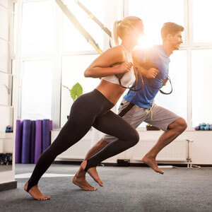 Man and woman using stretch bands
