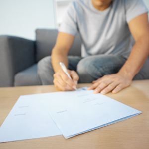 Man filling out paperwork