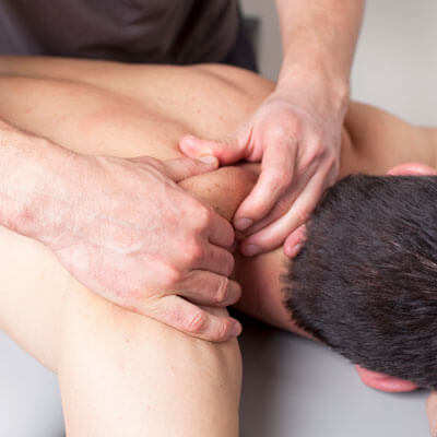 Man receiving massage therapy