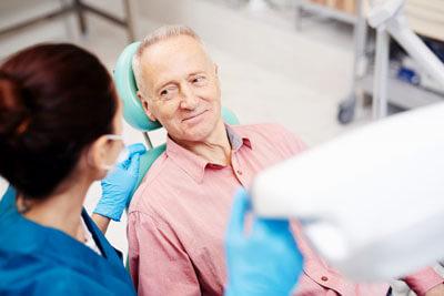 Man looking at dental tech