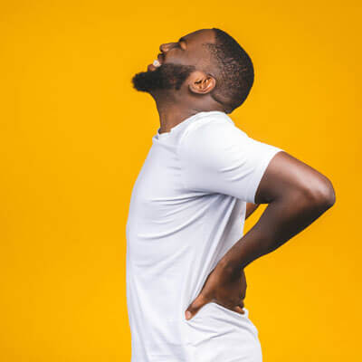 man with severe low back pain