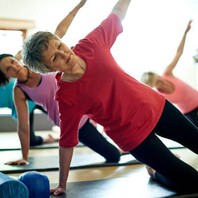 mature adult women yoga class