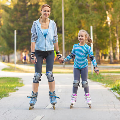 Mom and daughter roller blading