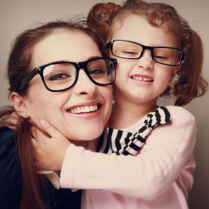 Mother and daughter with glasses, hugging