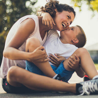 Woman laughing with boy