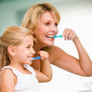 Mother daughter brushing