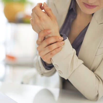 woman holding wrist in pain