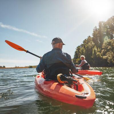Couple kayaking in water