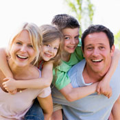 Happy, smiling family with young children