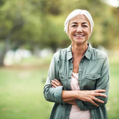 Elderly woman standing outdoors