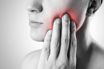 Woman holding side of jaw