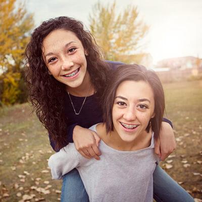 Sisters on piggyback