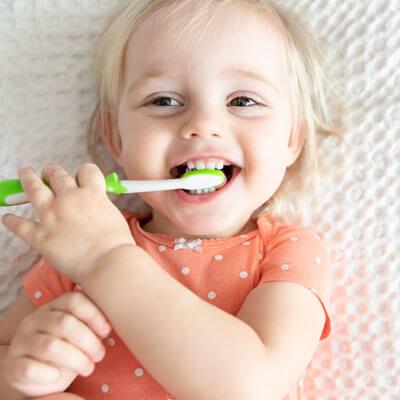 Cute child brushing teeth