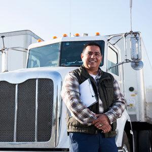 Man standing by big truck