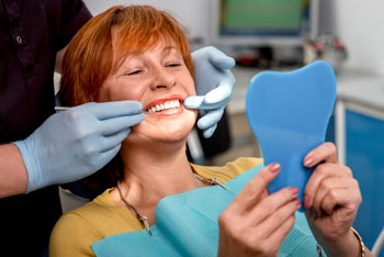 Woman getting fitted with dentures