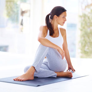 Lady stretching on yoga mat