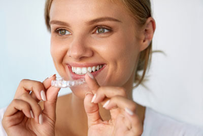 woman smiling with clear aligner