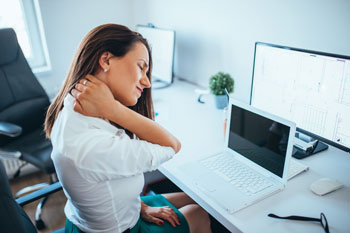 woman working with neck pain