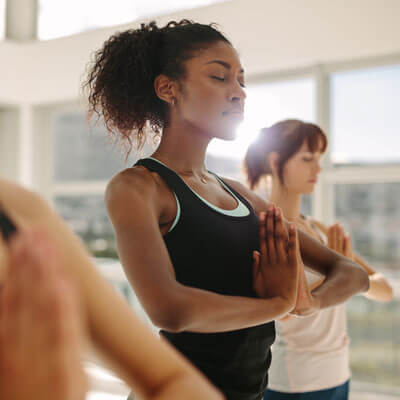 woman meditating in a group