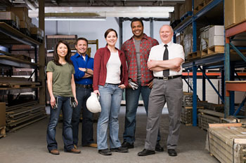 Employees standing in a warehouse