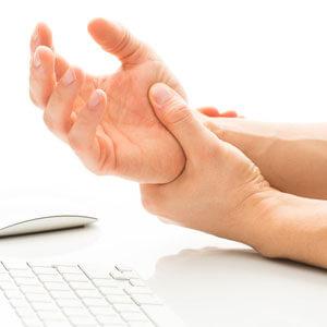 Person holding a sore wrist