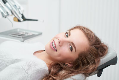 Young woman with braces at dentist