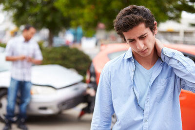 Young man with sore neck from auto accident