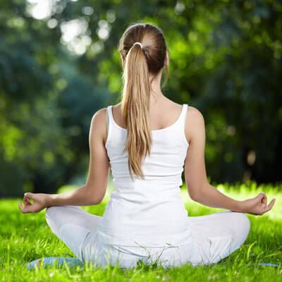 girl in the park meditatiing