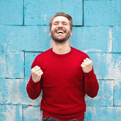 Very happy man wearing red shirt