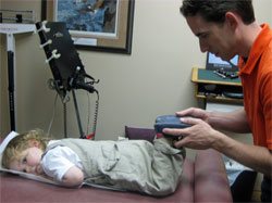 Dr. Bradley Jutzi adjusts a young patient