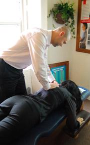 Dr. Kuzma adjusting a patient.