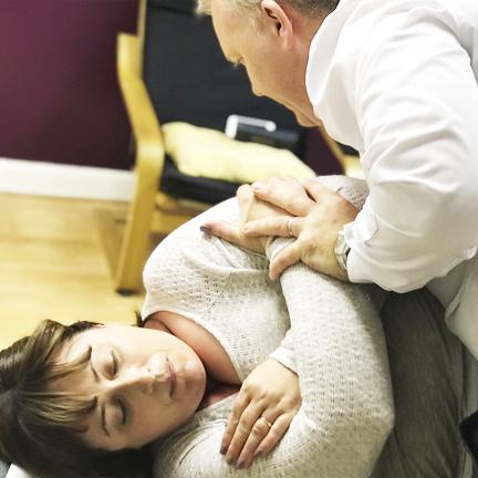 Chiropractor Dr Brian McElroy adjusting patient