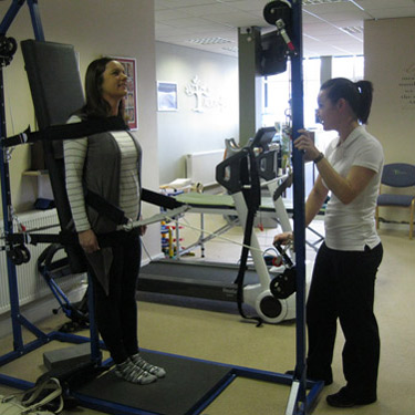 Staff with patient standing