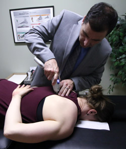 Dr. Todd adjusting chiropractic patient.