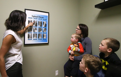 Dr. Tulk explaining spine health to chiropractic patients.