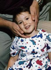 Dr. Fisher adjusting a child.