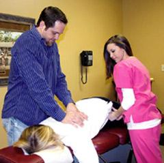 Dr. Deaton adjusting a patient.