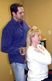 Dr. Deaton adjusts a patient.