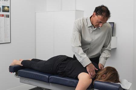 Dr Zuckerman adjusting a patient