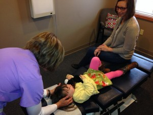 Columbia City Chiropractor, Dr. Lori adjusting a child